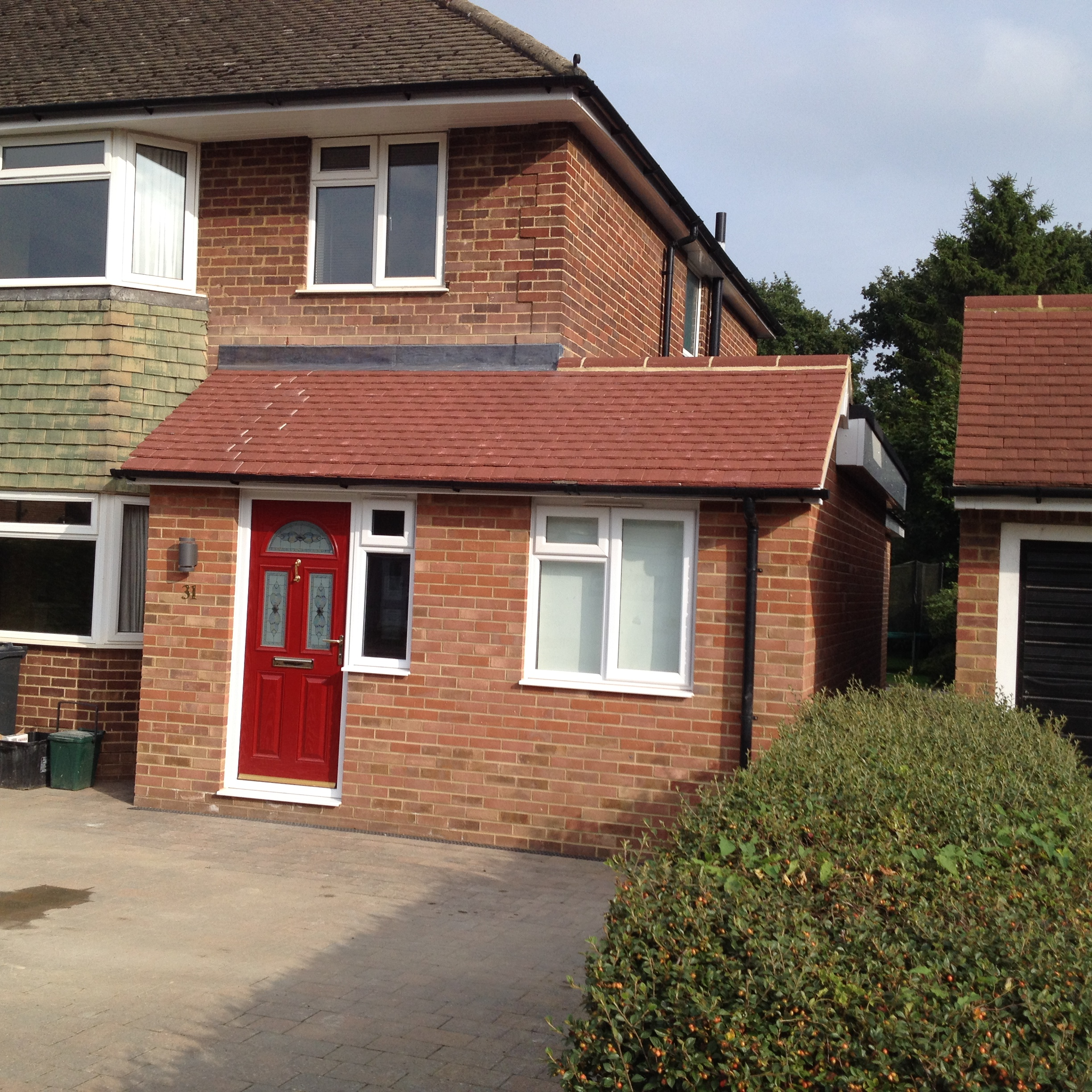 Completed extension porch and patio in horley wmd building for Garage extension cost estimate